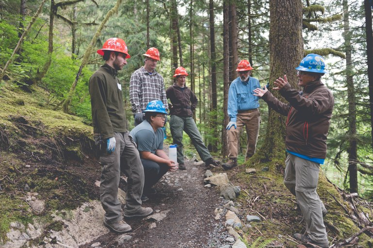 Discussing a trail project. WTA Archive.