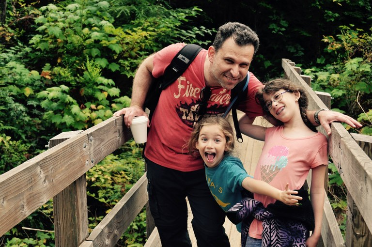 Parent with kids on bridge. Photo by Judith Furst