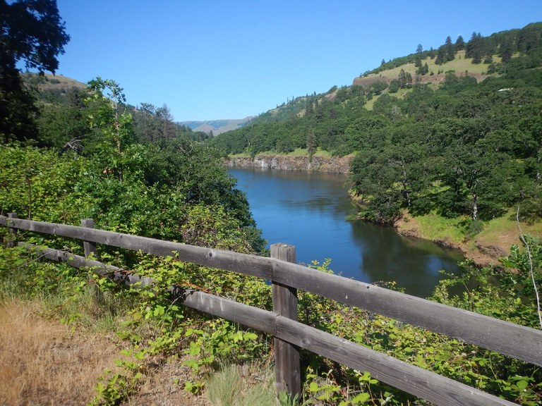 View through a split rail fence to the Klickitat River. Photo by Anna Roth