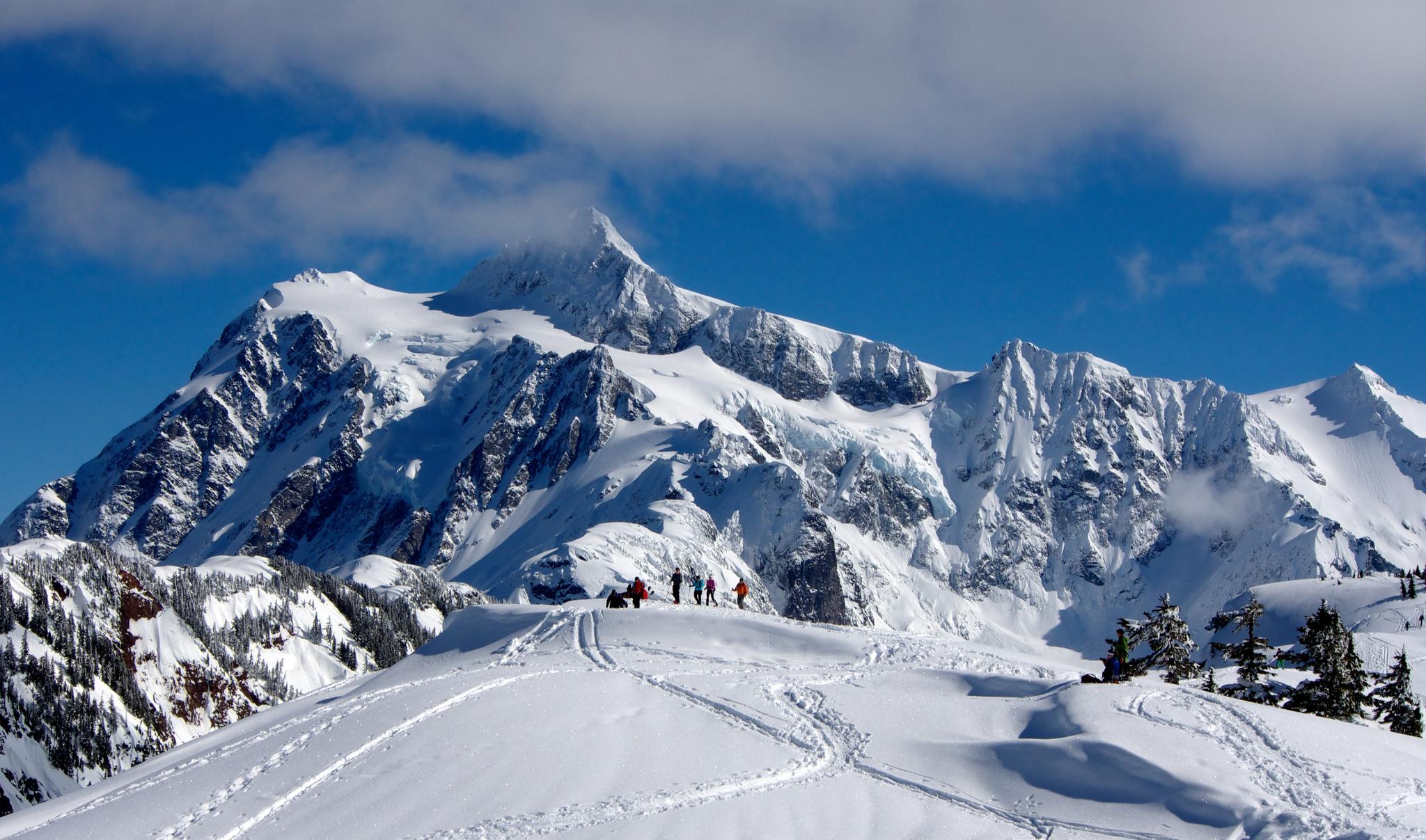 Snowshoers in front of Mount Shuksan. Photo by Eugene Kogan.jpg