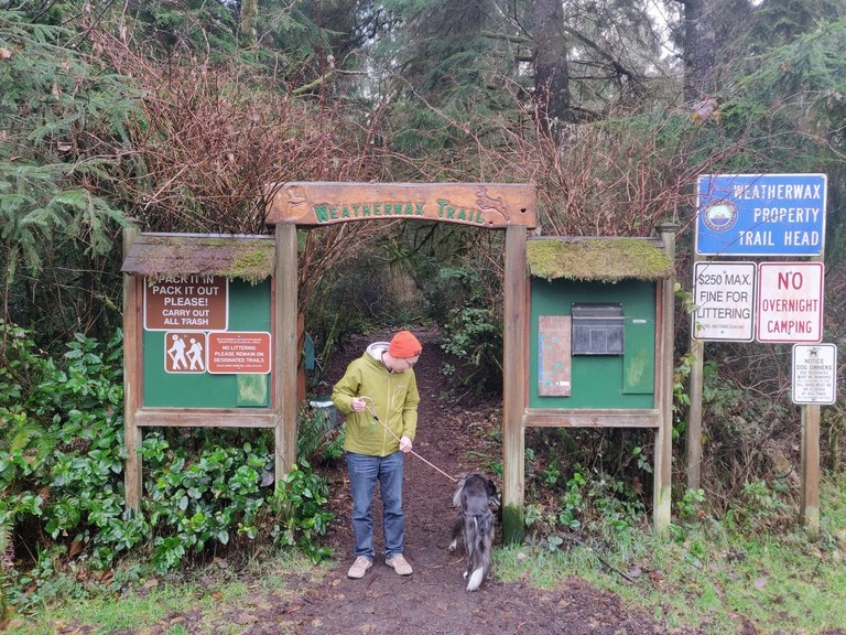 Arch and signboards at the entrance to the Weatherwax Trail. Photo by phlim89.