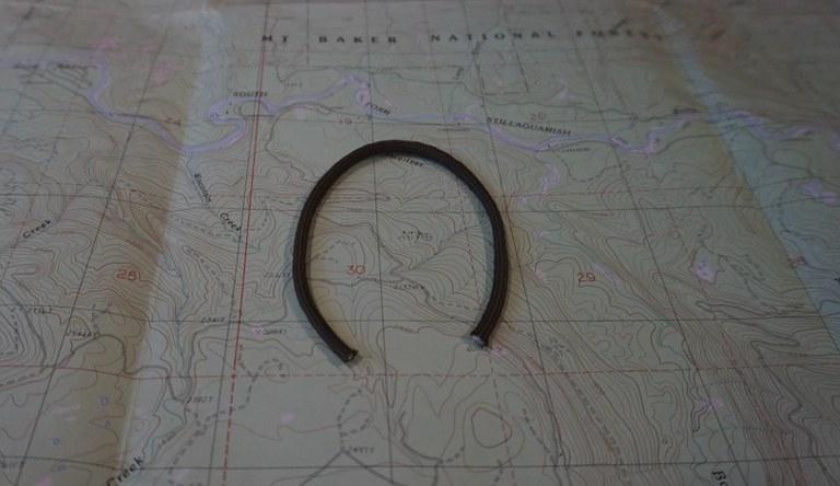 A horseshoe shape on a hiking map.