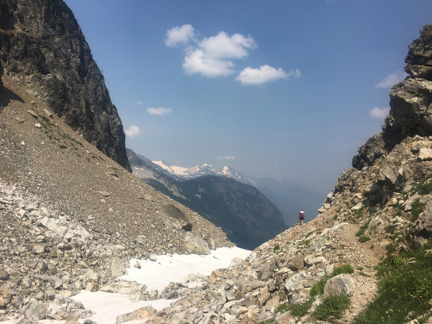 The view from Park Creek Pass opens up to reveal a long lush valley.