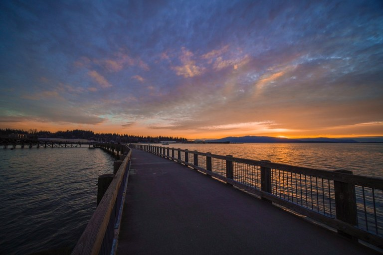 Pier stretching into bellingham Bay at sunset along the South Bay Trail. Photo by brittanywanderlust.