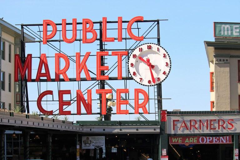 Large neon sign that says Public Market Center.