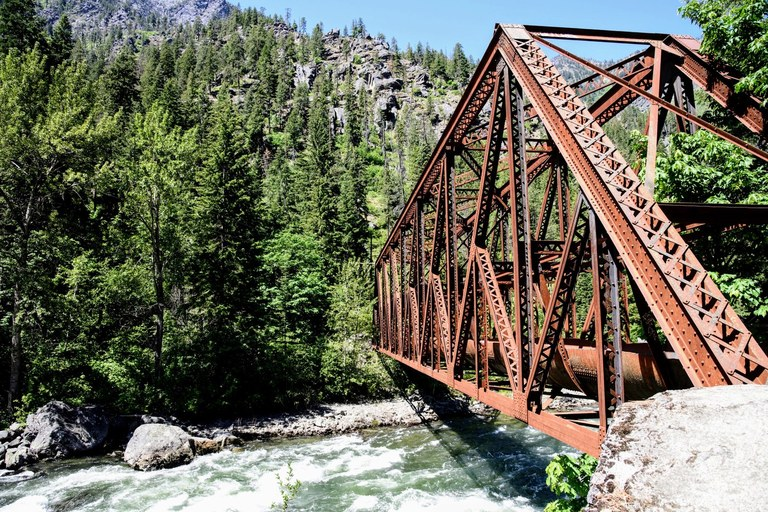A view of an old railroad bridge spanning a river. Photo by Spencer W. Bailey.
