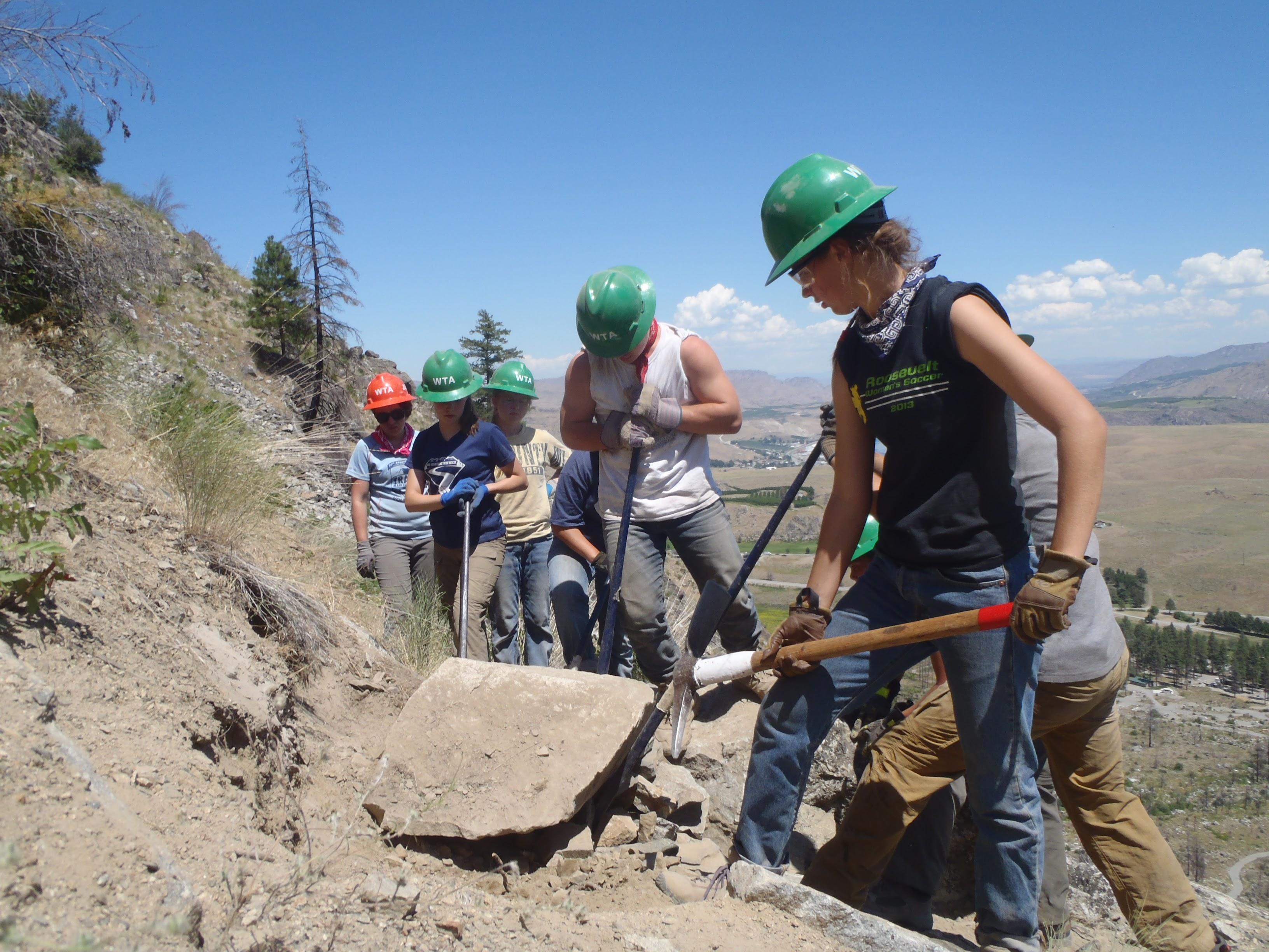 Crew moving large boulder.jpg