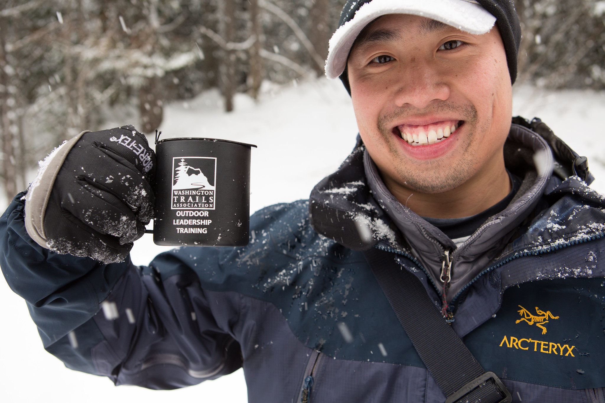 Enjoying a warm drink during an Outdoor Leadership Training snowshoeing workshop. Photo by Emma Cassidy.