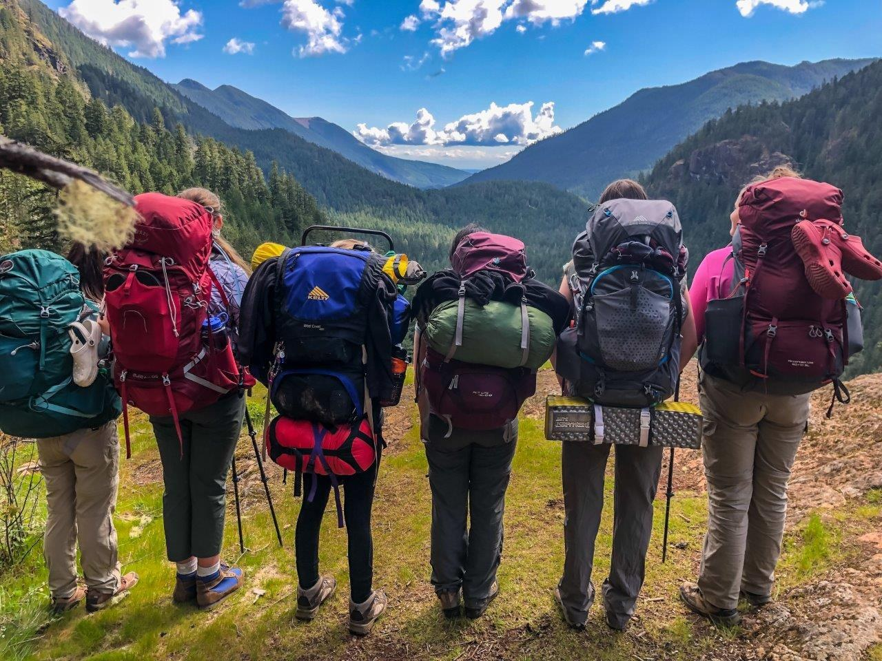 several hikers with big backpacks. Photo by Jasper and the Girl Scouts.