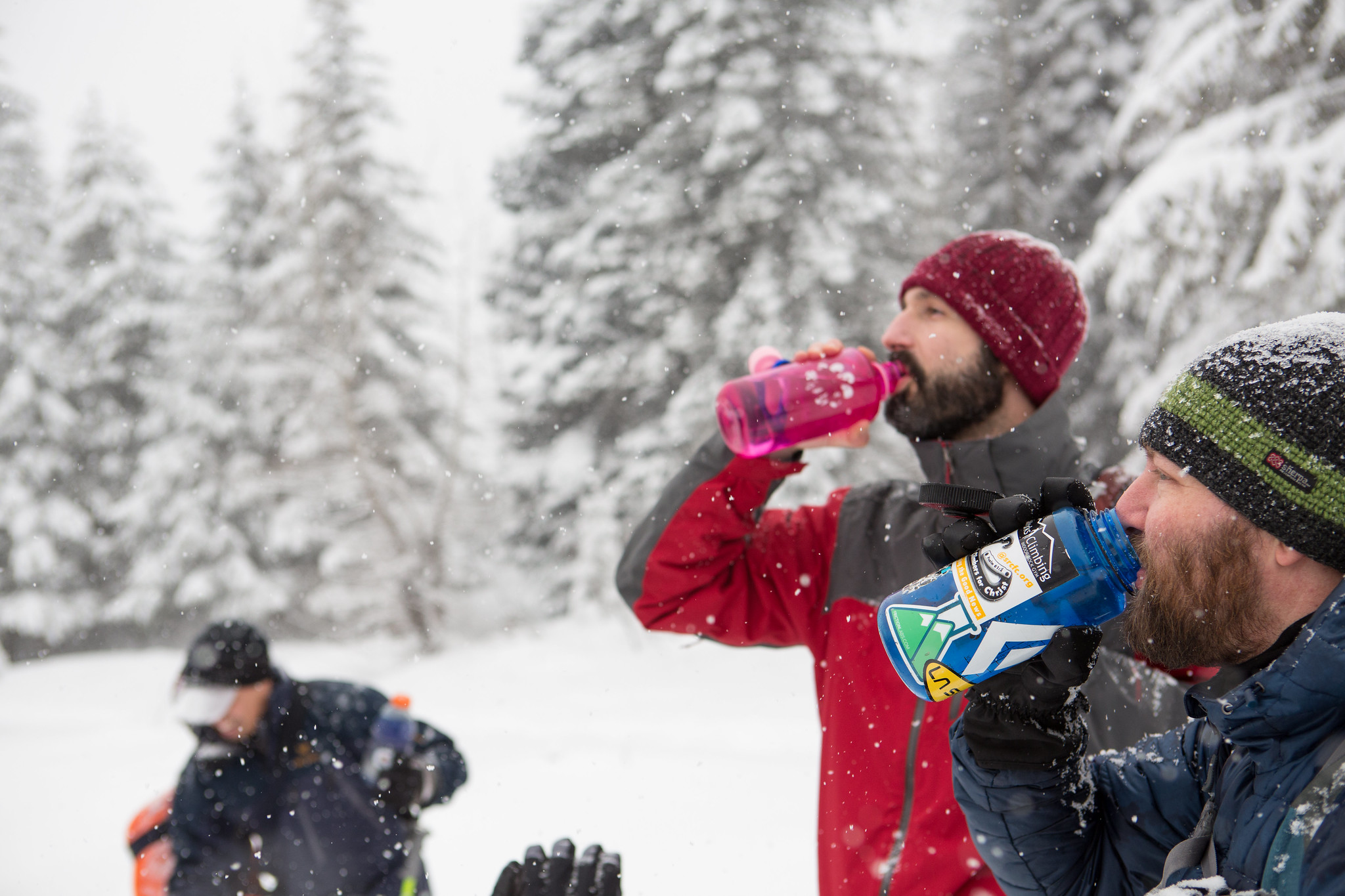 Participants in an Outdoor Leadership Training snowshoeing course stop for water. Photo by Emma Cassidy.