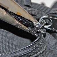 Fixing a zipper. Photos by Meg Erznoznik and Kristin Hostetter, courtesy of Falcon Guides.