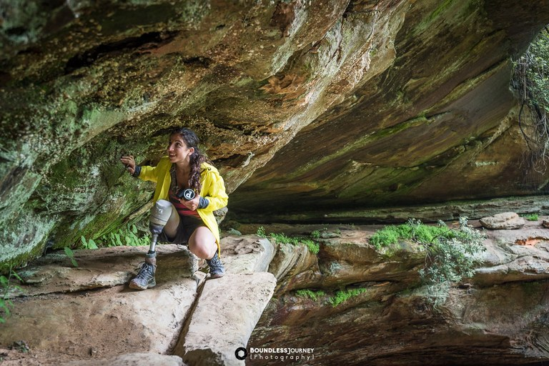 Angelina in a cave. Photo by Boundless Journey Photography.