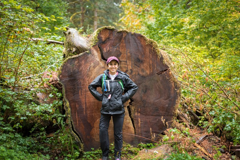 Angelina posing by fallen tree. Photo by Nick Martinson.