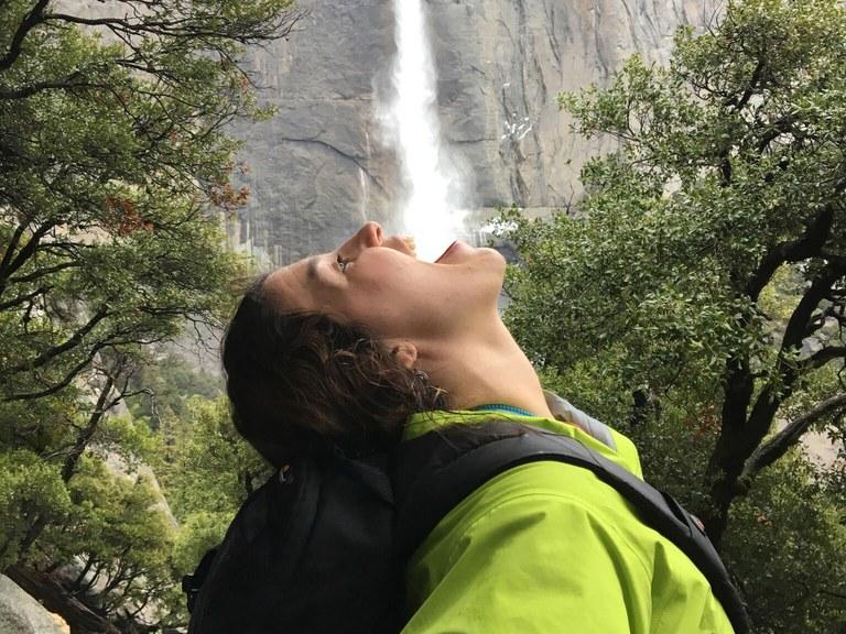 Bianca drinking a waterfall. Photo courtesy Bianca Fernandez.