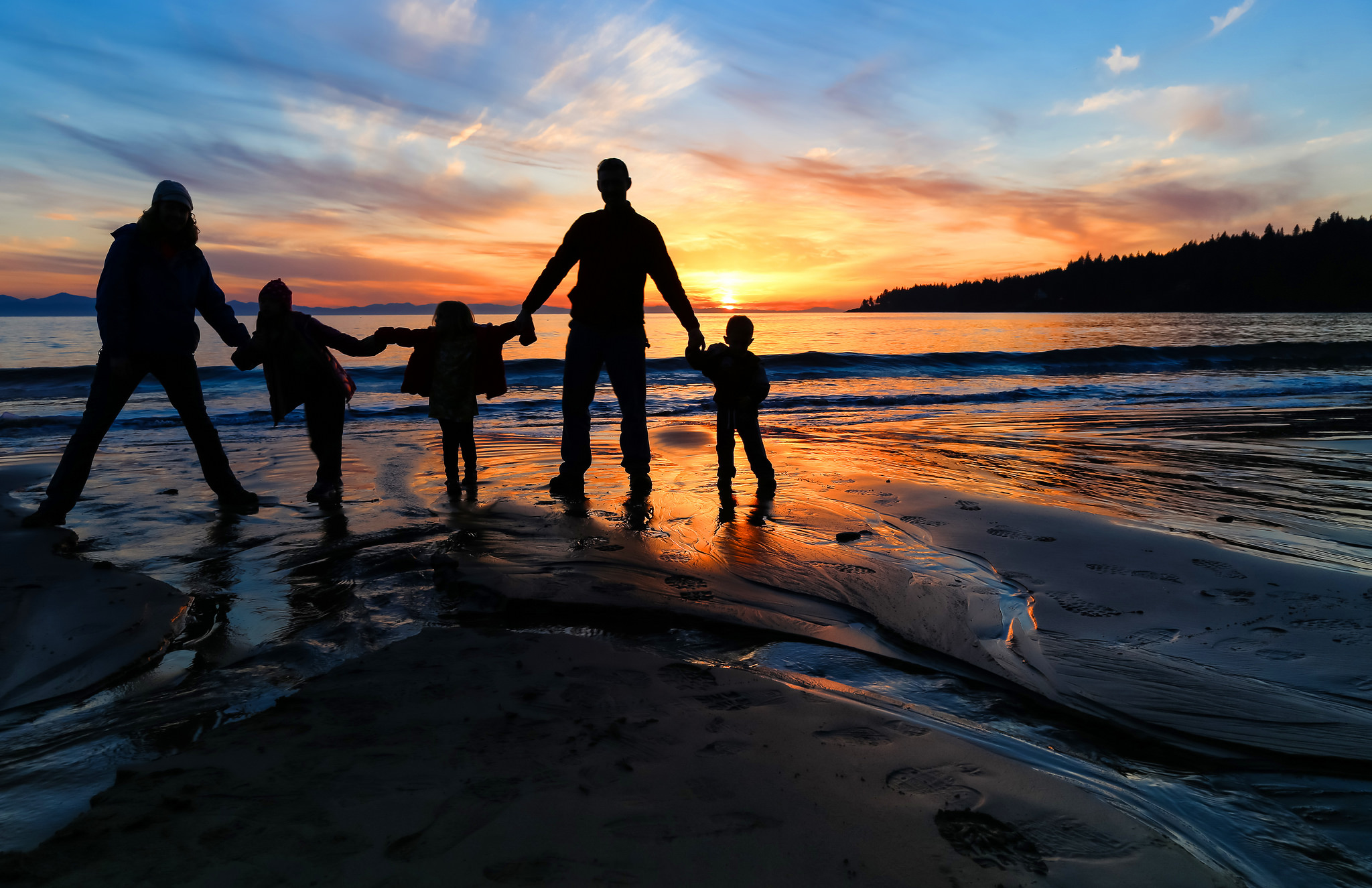 Family on the beach. Photo by Brian Koning.