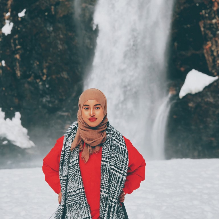 Hamziye in front of waterfall. Photo courtesy Hamziye Aman.