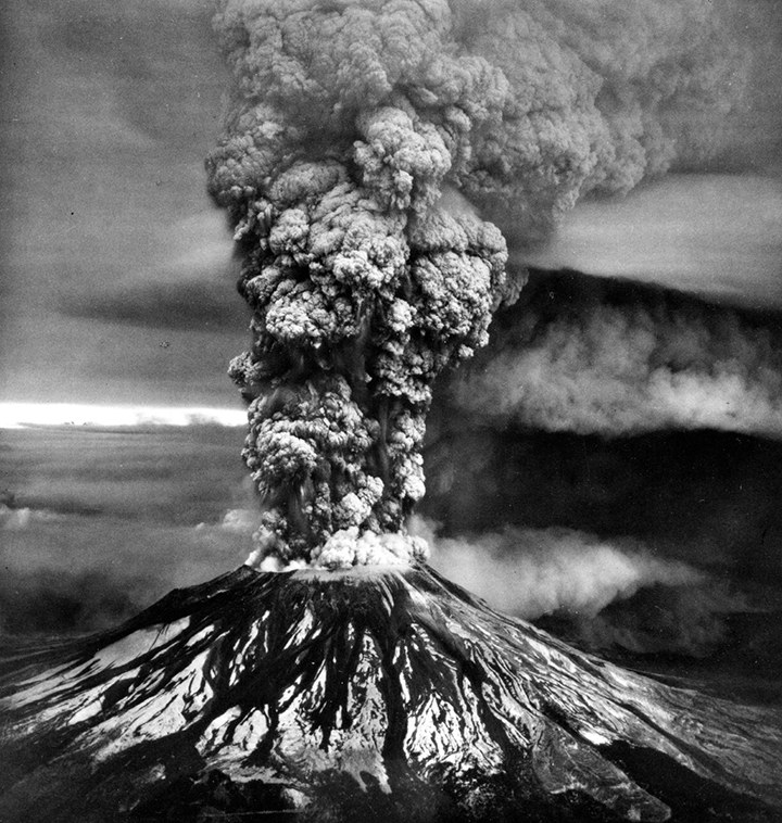 Iconic black and white photo of a plume of ash rising high about Mount St. Helens.