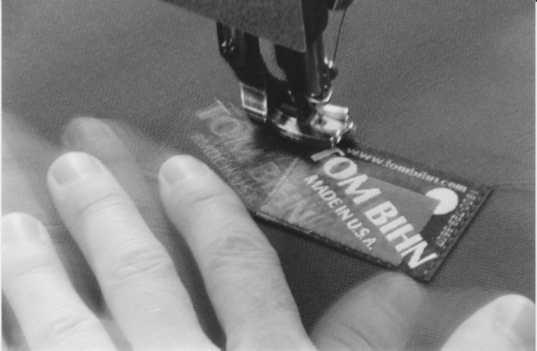 SC Store sewing the label.jpg