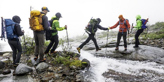 A helpful hand keeps a hiker from a wet landing!  by Mike Warren