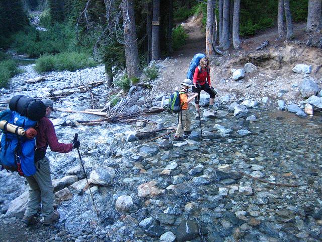 Hikers crossing Leroy Creek