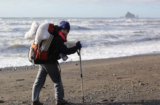 Elissa smiles on a beautiful day backpacking the Olympic coast. Photo courtesy Lorelei Felchlin.