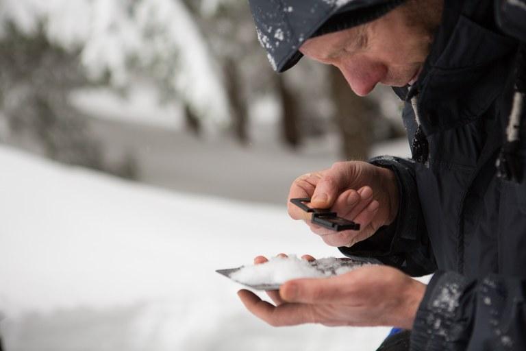 Analyzing snow. Photo by Emma Cassidy..jpg