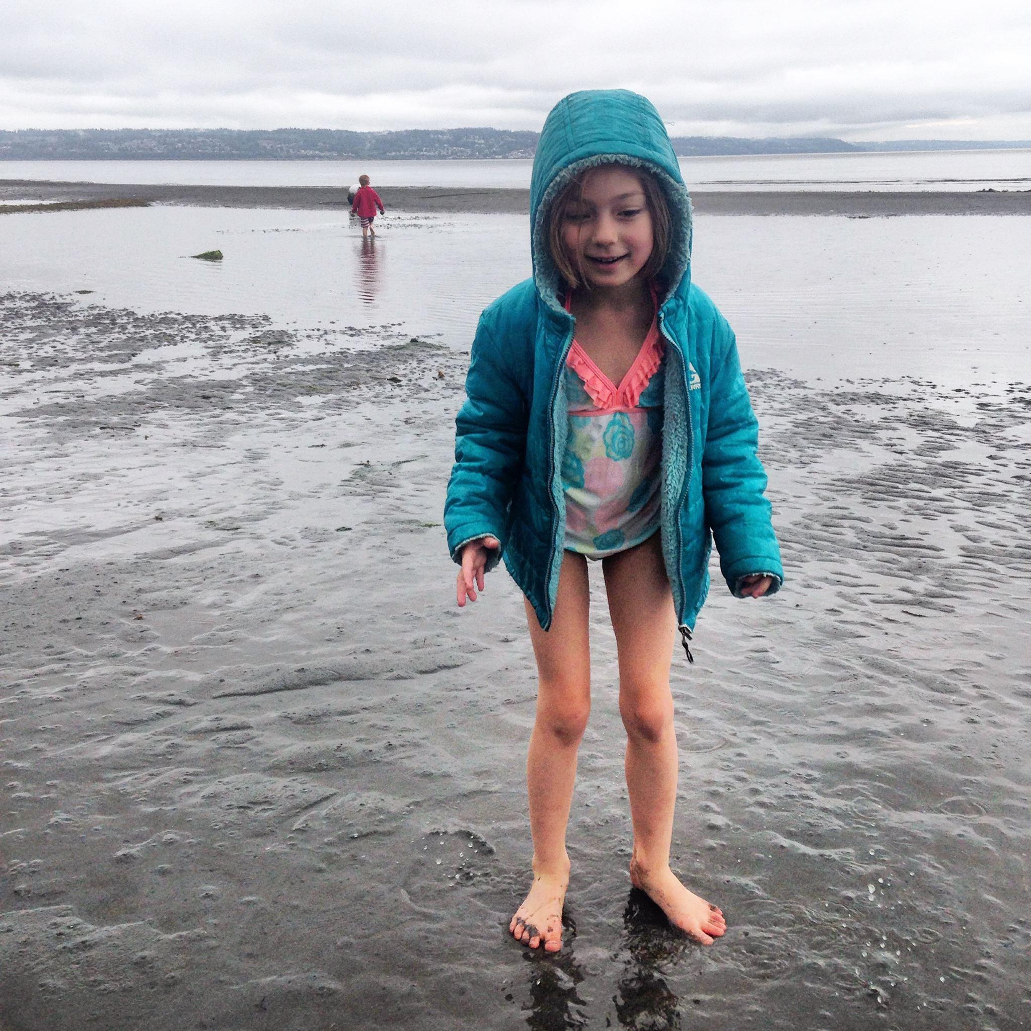 kid in bathing suit in water