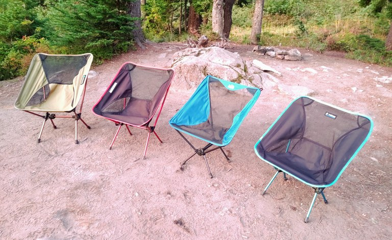 Four empty camp chairs in a row.