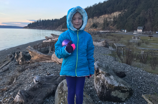 kid at campground in coat in winter