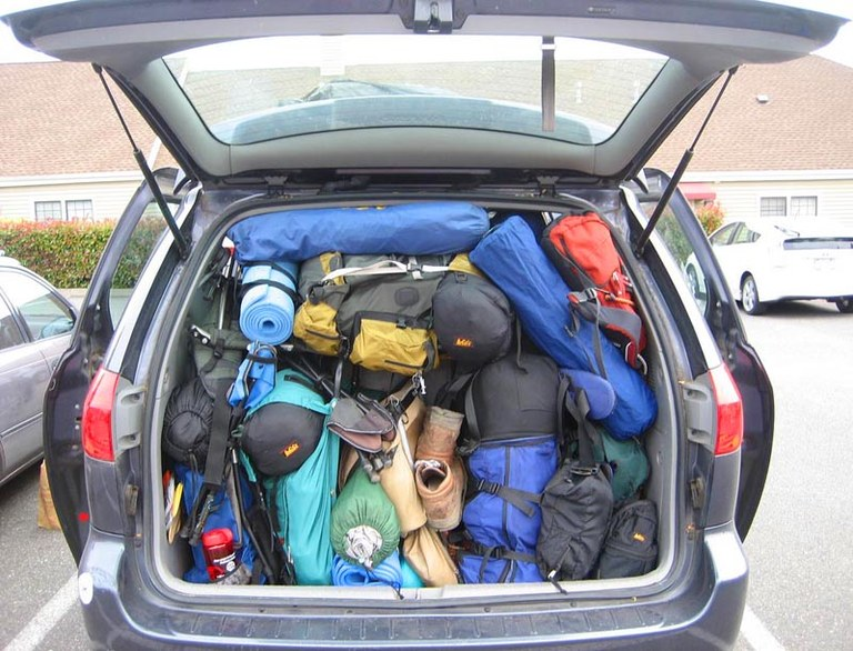 The back of a station wagon is packed to the ceiling with hiking gear. Photo by Joe Curiel.