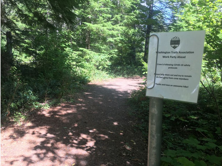 Sign notifying hikers that crew is working according to COVID protocols. Photo courtesy Stasia Honnold.