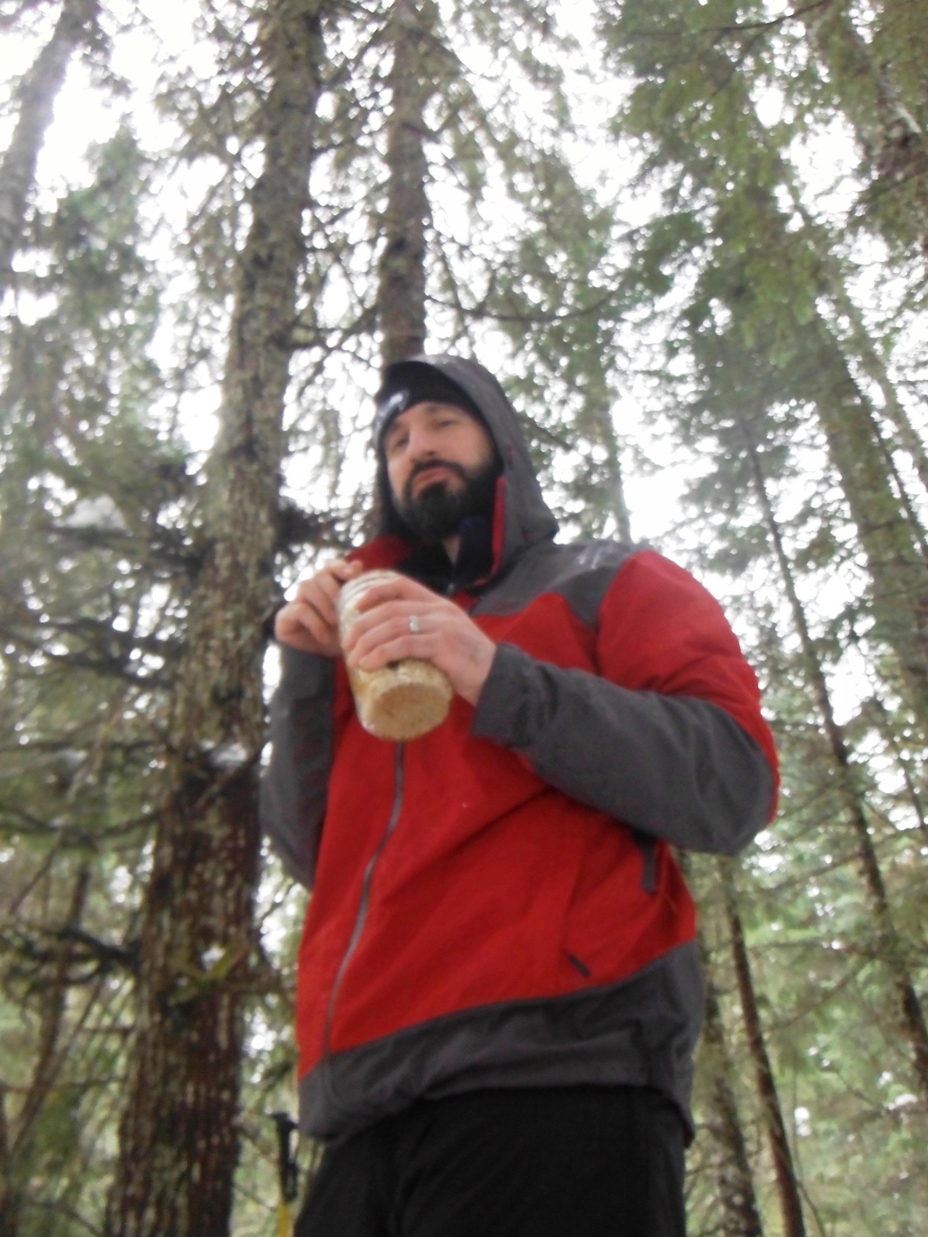 Outdoor Environmental Education Club leader Alessandro Scilletta regards a resting snowshoer.