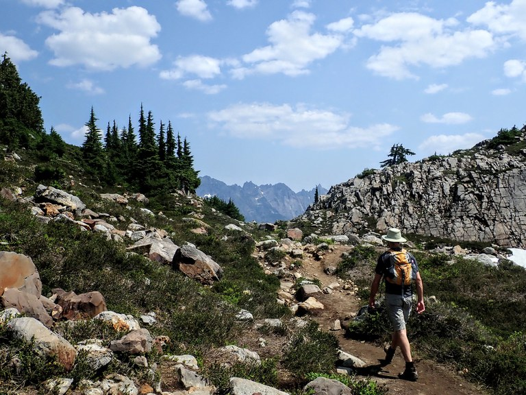 Hiker heading out of Gothic Basin. Photo by Chelsey Morar.