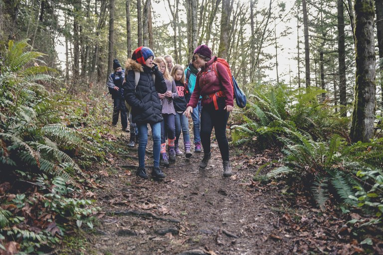 Ingrid Phillips hikes with a group of fourth graders. Photo by Britt Lê.