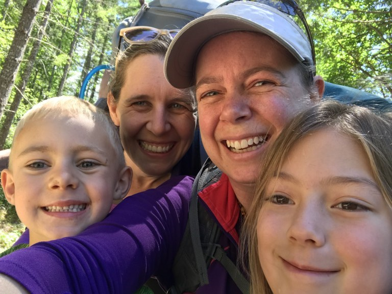 A selfie with two women and two kids.