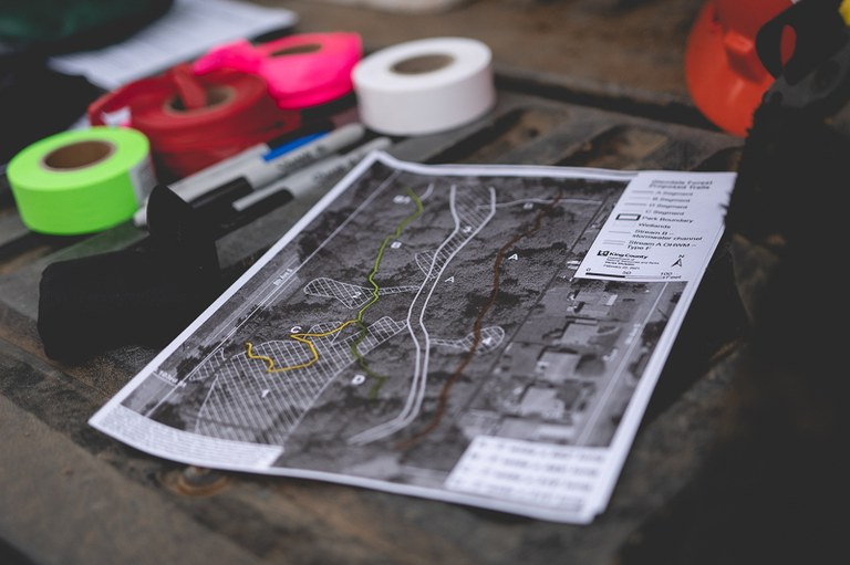 The tools of trail layout and design, plans and lots of flagging materials!