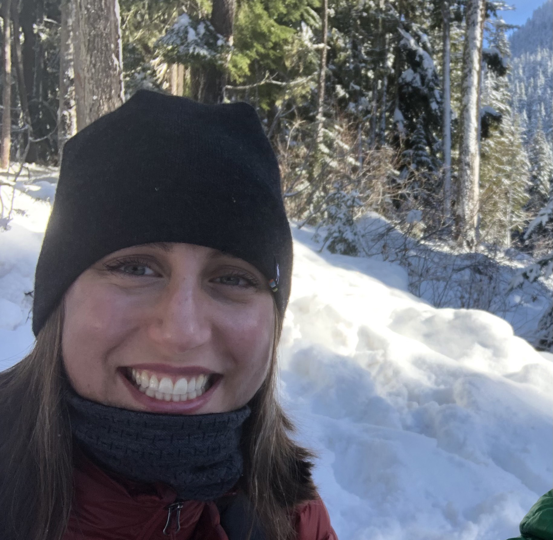 Leah Dobey, smiling for a selfie with snow in the background.