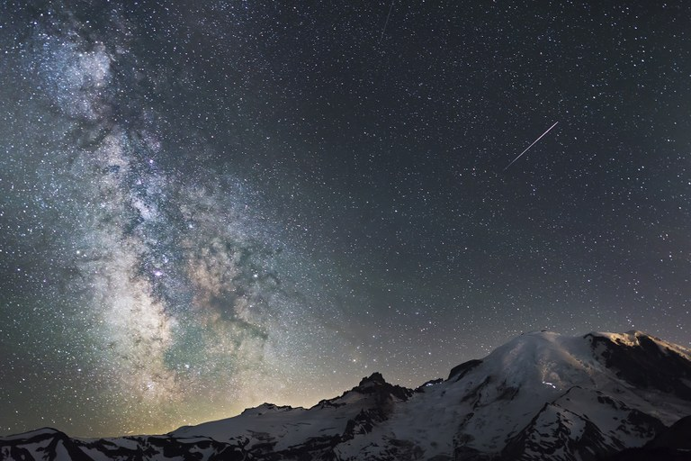 Night sky at Mount Rainier with a shooting star.
