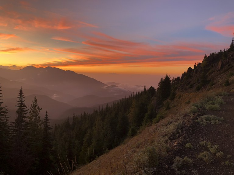A long view down a mountain valley at sunset. Photo by Suzanne Sowinska.