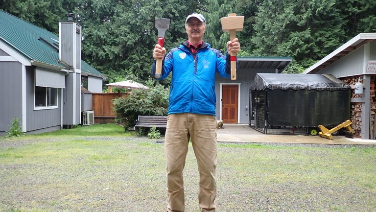 Jim with his homemade mallet and chisel.