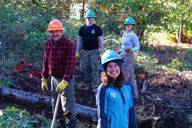 A volunteer crew smiles at the camera during a day of work at Ridgefield.