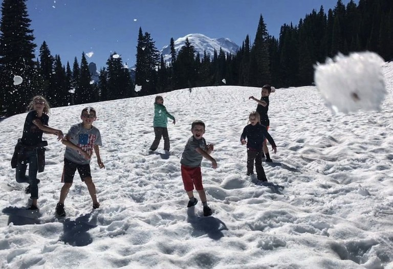 Five children throw snowballs toward the camera. Photo by Malissa Waterford.