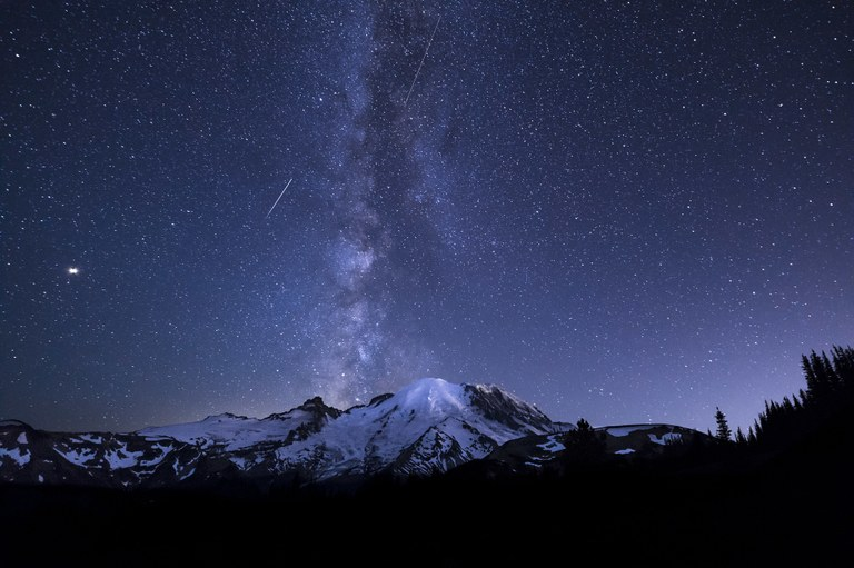 Milkway way rising over Mount Rainier with a single shooting star.