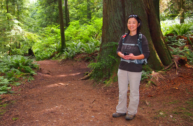 Tomoe grins at the start of a geocaching hunt. Photo by Kathy Bogaards.