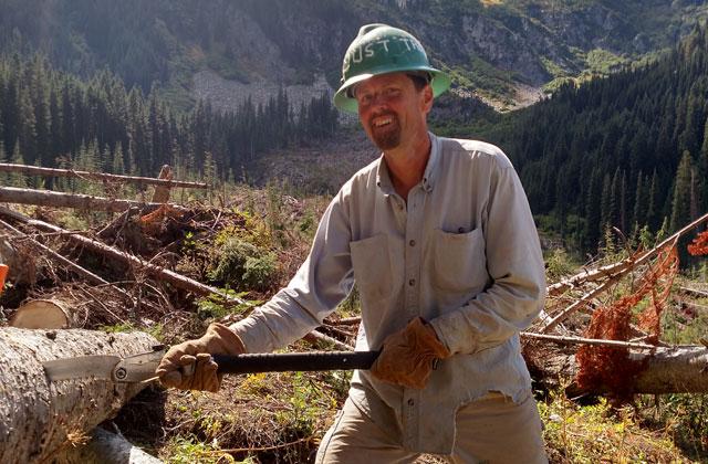 volunteer sawing log with silkie mcbride