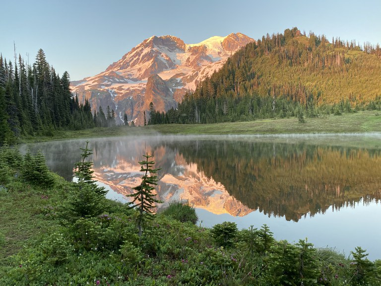 Mount Rainier reflected in a small lake.