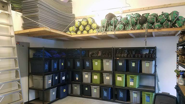 Shelves at the Gear Library with sleeping pads and bags