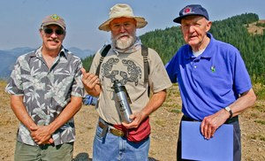 Volunteer Bob Adler, who helped coordinate the restoration of the Kelly Butte Lookout, poses with past fire lookouts Daniel Lean and John Sandor. Photo by Kim Brown.