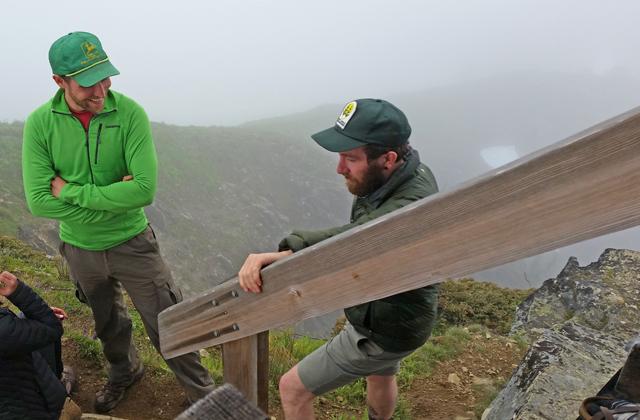 Ranger talking to hiker Loren Drummond