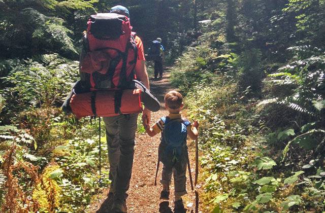 Dad and son on trail hilary l benson